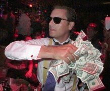 Scott Disick throws money on crowd, swings fake axe at friend at Halloween bash in Las Vegas!